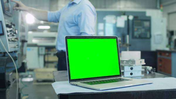 Notebook with green screen in industrial environment mock-up Royalty-free stock video