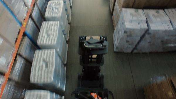 Aerial overhead shot of working forklift loader inside logistic warehouse Royalty-free stock video