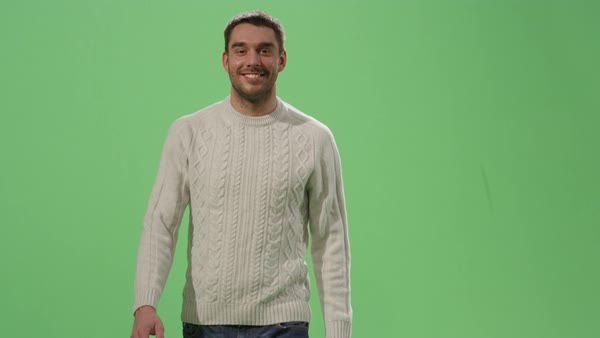 Casual caucasian man is walking on a mock-up green screen in the background. Royalty-free stock video