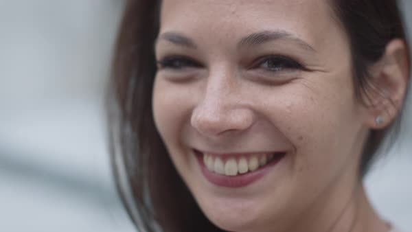Portrait of attractive smiling young woman in urban environment. Royalty-free stock video