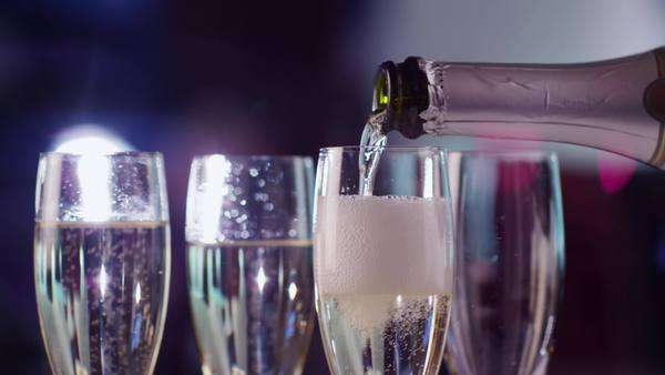 Pouring champagne into glasses are being filled at party Royalty-free stock video