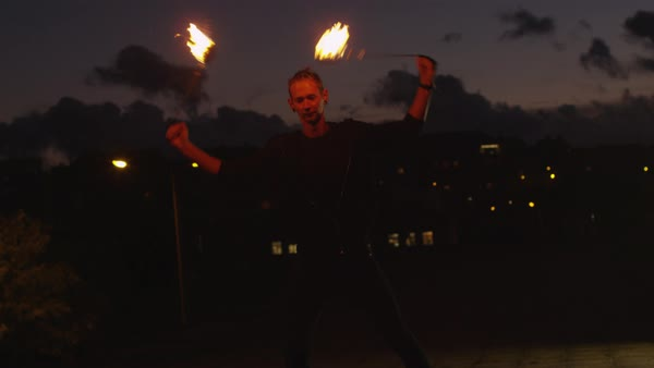 Male artist performing fire show outdoors at evening time. Royalty-free stock video
