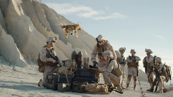Soldiers are Using Drone for Scouting During Military Operation in the Desert. Slow Motion. Royalty-free stock video