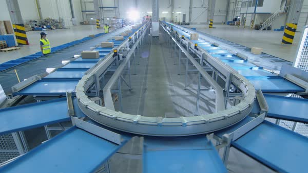 Working large belt conveyor with parcels at sorting post office. Royalty-free stock video