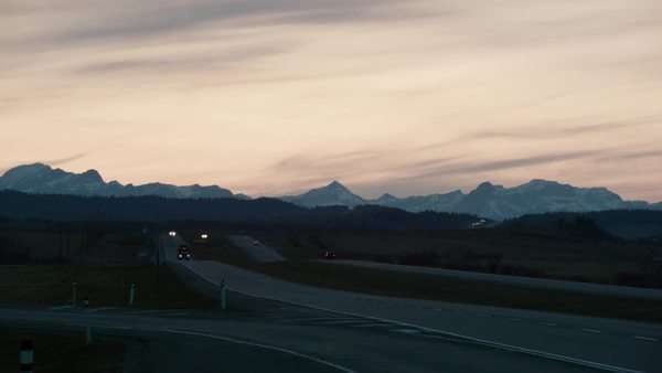 Wide-angle shot of traffic on a highway at dusk Royalty-free stock video