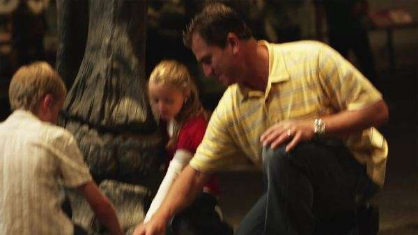 Medium shot tilt-up of Man with daughter and son in natural history museum Royalty-free stock video