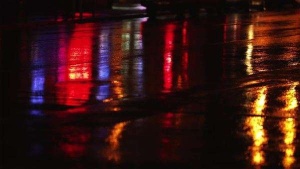 Close-up of city lights reflected in wet street at night, New York City, New York Royalty-free stock video