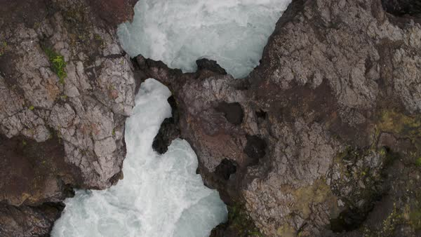 Wide high angle shot of river rapids flowing between rocks Royalty-free stock video