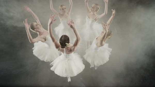 Medium slow motion high angle shot of ballerinas dancing in circle Rights-managed stock video