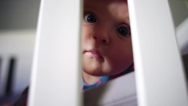 Low-angle shot of a baby reaching out of a crib Royalty-free stock video