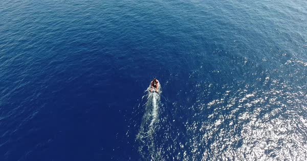Aerial of motorboat start in the blue sea Royalty-free stock video