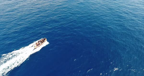 Aerial of motorboat goes across blue sea surface with white trail Royalty-free stock video