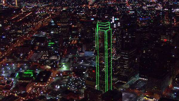 Aerial Footage Dallas Texas . Aerial Footage Of Dallas Texas. The Large  Skyscrapers Light Up The Night Sky With Bright Neon Lights.