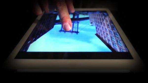 An extreme close-up of manipulating a photo on a touchscreen tablet. Royalty-free stock video