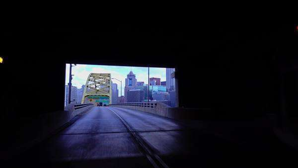 PITTSBURGH, PA - Circa November, 2015 - A view of Pittsburgh as you emerge from the Fort Pitt Tunnels. Royalty-free stock video