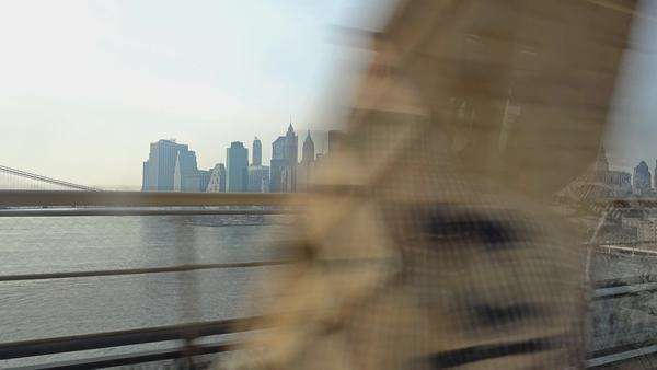 NEW YORK - Circa December, 2015 - The Manhattan skyline as seen from a subway car crossing the Manhattan Bridge. Royalty-free stock video