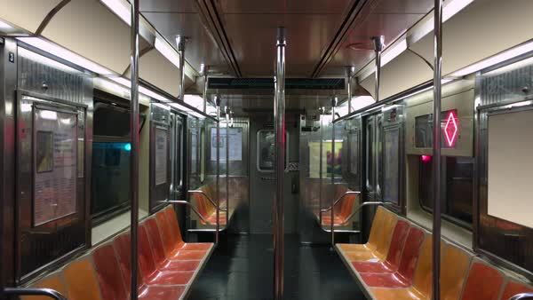 Loopable interior establishing shot of an empty New York City subway car as it travels along the tracks Royalty-free stock video