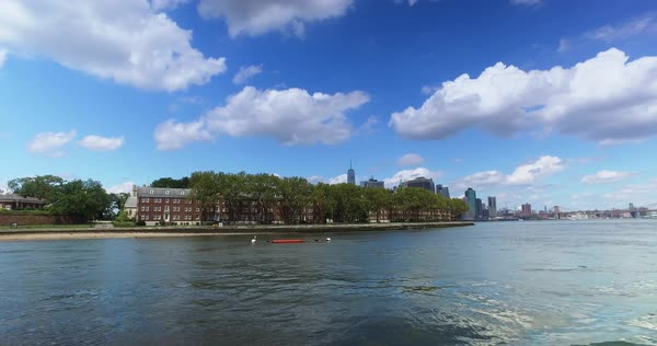 A view of the Governors Island shoreline with the Freedom Tower peeking above in the background.  	 Royalty-free stock video