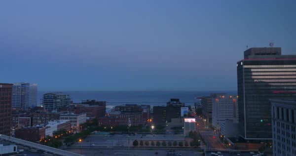 A morning sunrise timelapse shot of the Cleveland skyline with Lake Erie in the distance.  	 Royalty-free stock video
