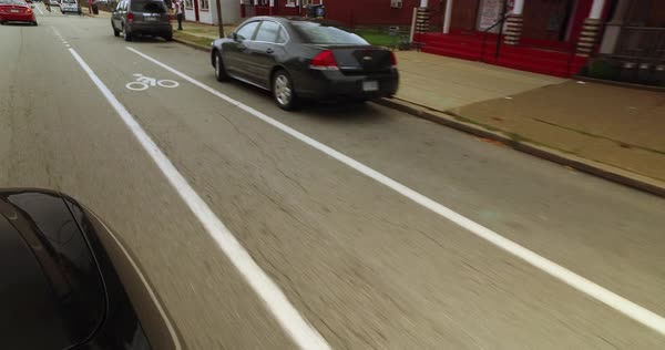 A detailed view of a dedicated bicycle lane on the street of Pittsburgh's Bloomfield area.  	 Royalty-free stock video