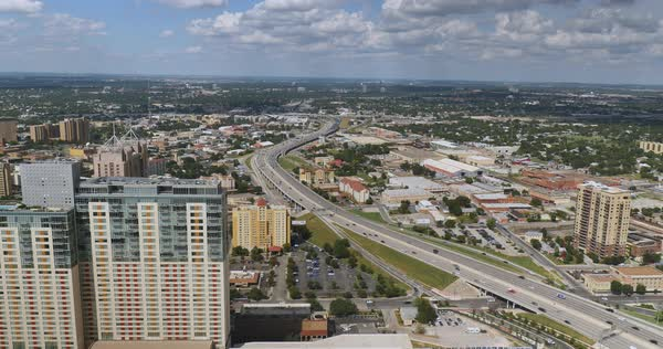An aerial view over the skyline of San Antonio, Texas and Interstate 37.  	 Royalty-free stock video