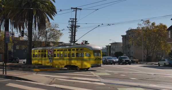A streetcar passes by on Market Street in downtown San Francisco.  	 Royalty-free stock video