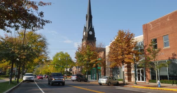 A daytime establishing shot of businesses and a church on a typical Main Street in America. Pittsburgh suburb.  	 Royalty-free stock video