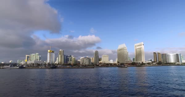 A wide, dramatic early evening establishing shot of the San Diego city skyline as seen from the bay.	 	 Royalty-free stock video
