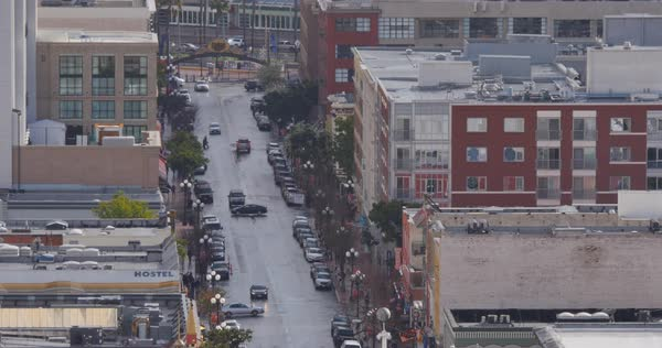 A long aerial shot of traffic on Fifth Avenue in San Diego's Gaslamp Quarter.  	 Royalty-free stock video