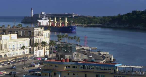A large freighter cargo ship pulls into Havana Port Bay in Cuba.  Royalty-free stock video