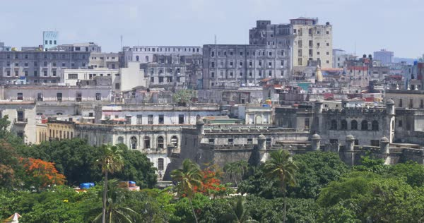 A high angle daytime establishing shot of old buildings near the Havana Port Bay in Cuba.   Royalty-free stock video