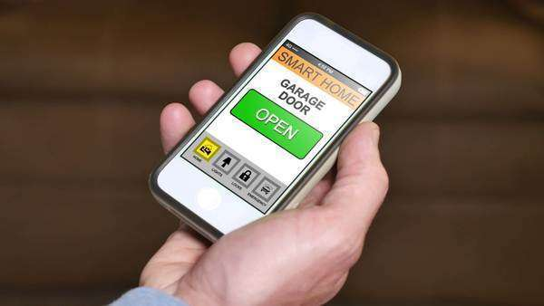A closes his garage door remotely with a smartphone app. Royalty-free stock video