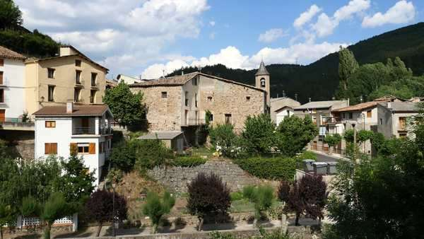 A view of the church, houses and the main road in Senterada in the Pyrenees. Royalty-free stock video