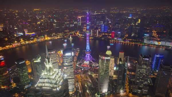 World Financial Center View of Shanghai and Pudong at night, birds eye. Rights-managed stock video