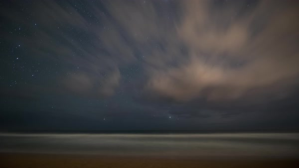 Long exposure, dreamy tropical coast, night sky, star timelapse. Rights-managed stock video