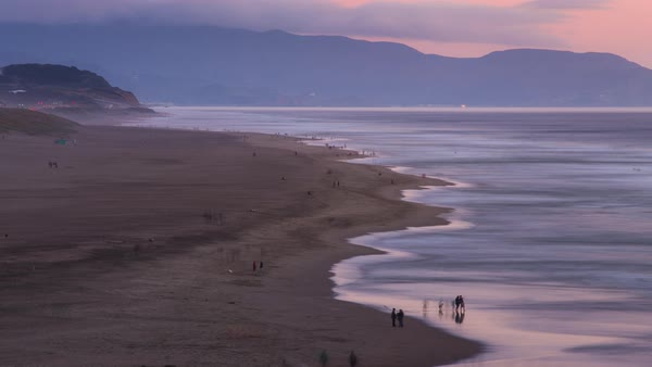 Stop Motion timelapse, people at the beach during sunset. Rights-managed stock video