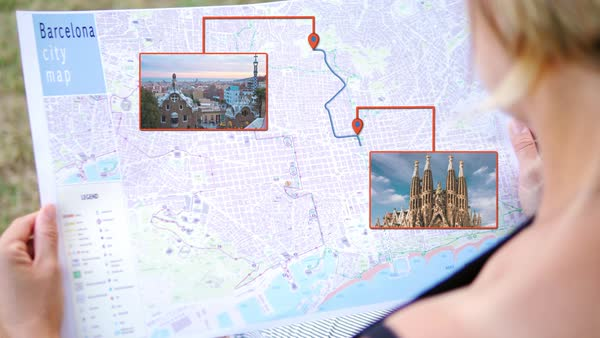 Tourist holding barcelona city interactive map top attractions ...