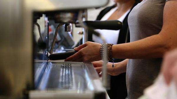 Profile shot of two people hands making a latte from beginning to end Royalty-free stock video