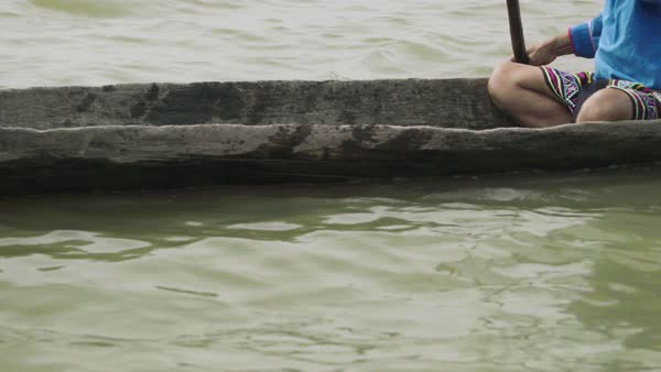 Tracking shot of a woman rowing a canoe on Ucayali River in Peru Royalty-free stock video