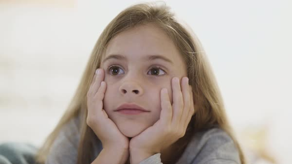 Hand-held shot of a girl watching television Royalty-free stock video