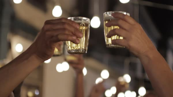 Close-up shot of hands toasting with glasses Royalty-free stock video