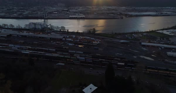Panning aerial over rail yard at sunset. Royalty-free stock video