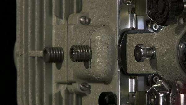 Tracking close shot of 16mm film projector stock footage
