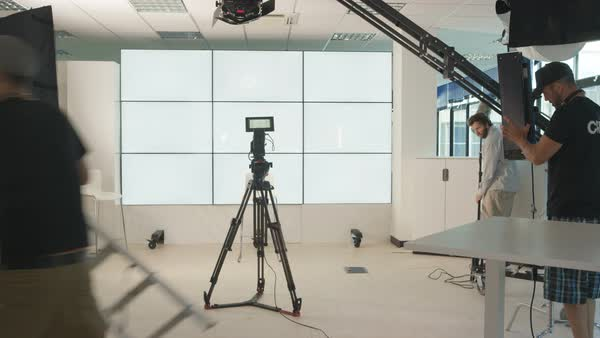 Time lapse of TV crew in studio, setting up for a shoot & packing away after. Royalty-free stock video