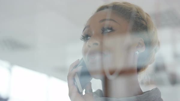 Close up beautiful businesswoman talking on cell phone in the office. Royalty-free stock video