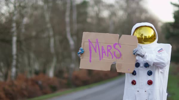 Astronaut returned to earth trying to hitch a ride from passing traffic. Royalty-free stock video