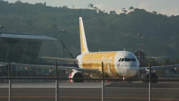 PHUKET, THAILAND - NOVEMBER 26, 2015: AirAsia Airbus 320 Amazing Thailand  livery HS-ABX taxiing on the runway before take-off stock footage
