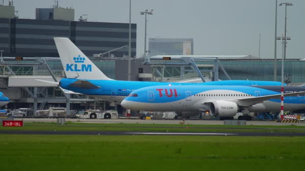 AMSTERDAM, THE NETHERLANDS - JULY 27, 2017: Boeing 737 KLM PH-BXL and  TUIfly Boeing 787 Dreamliner taxiing before departure, Boeing 777 KLM  PH-BVK