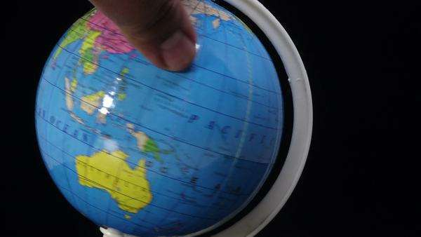 Map Of The World Globe View.A Thumb Scrolling The World Globe Fast Black Background Close Up View Stock Footage