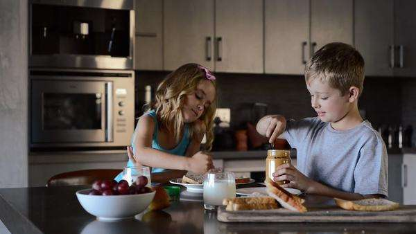 Siblings eating sandwiches and making food lunch together Royalty-free stock video